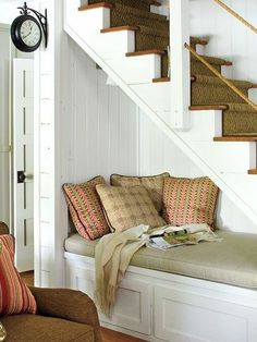 Under the stairs reading spot. Clever!