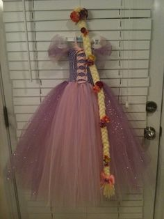 Rapunzel. The costume @Candyce Johnson we could totally do something like this and use a t-shirt for the top/bodice and then a tulle skirt.