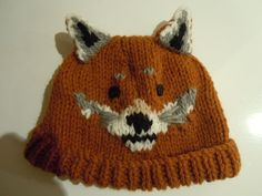 Hand knitted fox hat Pat Wood at pats knitted hats on Etsy. I bought this and love it. And what does the fox say? runs thorough my mind in a most pleasant way.