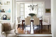 A simple dining room connects the living and family rooms through wide doorways