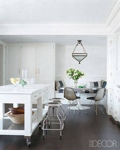 A white and simple kitchen by designers Nate Berkus and Anne Coyle.