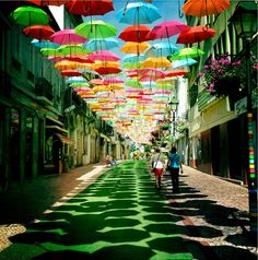 A street that reminds us of Mary Poppins :)  Portugal.   Check out travel plan in #Lisbon, #Portugal shared by our traveler Marcia: http://wishbeen.com/#!/plans/a35f35b86304f962  #travelplan #umbrella #travelplanner #travelplanning #traveltheworld #tripplanner #tripadvice #travelphotography #adventure #beautiful #colorful #myjourney