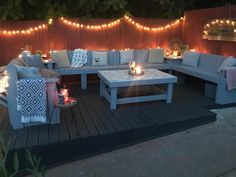 DIY couple build stunning seating area using pallets from Facebook Marketplace | LatestDeals.co.uk Pallet Seating, Outdoor Seating Areas, Pallet Furniture, Outdoor Furniture Sets, Outdoor Decor, Corner Garden Seating, Blue Pallets, Wooden Pallets, Blue Garden