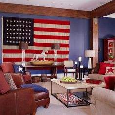 Patriotic blue  A large vintage American flag, pillows with star motifs and navy walls (Glidden #1526 Federal Blue) play up the patriotic theme in this Indiana room. The deep-blue walls make the large room seem more intimate, as darker colors tend to do. Rather than using a bright white, all accents coordinate with the tea-stained white of the flag, which keeps contrast low and the color scheme muted.