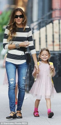 Bundles of laughs: Sarah - seen holding Tabitha's hand - opted for a more casual look as s...