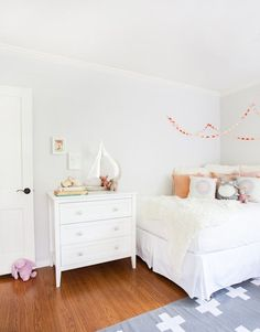 A guest bed in the nursery: Schuyler's Soothing Room with Peach & Pink Accents