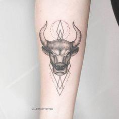 bull tattoo on arm