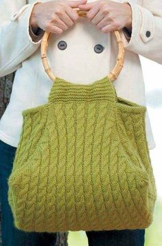 """Knitting Pattern for Multi-Cabled Bag -This cable purse is created in panels. Dimensions: 14"""" (35.5 cm) square (at base) by 9"""" (23 cm) tall. Designed by Kim Haesemeyer."""