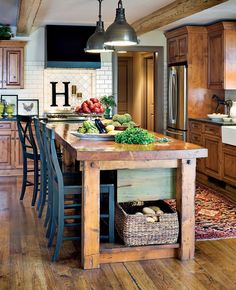 Love this farm kitchen table / bar / island with colored chairs Like the initial on the back splash