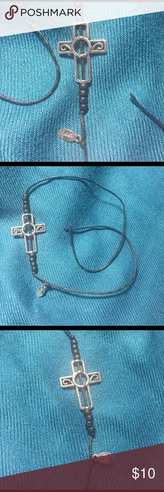 """Juliet Simms Cross Bracelet Purchased from Juliet Simms, Singer and runner-up The Voice Season 2, through her Pledgemusic campaign to fund her EP All or Nothing. Never worn, the silver cross and beads are strung on black cord and measures 14"""" in length. Jewelry Bracelets"""