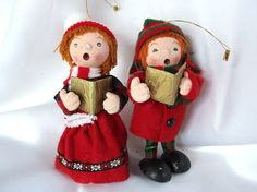 Vintage carolers Christmas ornaments feature paper mache faces with hand painted details, felt and wool plaid clothing, knit hats with pompoms
