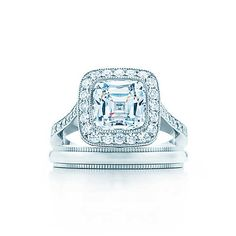 This patented cushion-cut Tiffany diamond <br>surrounded by bead-set diamonds <br>evokes the glamour of the Edwardian period.