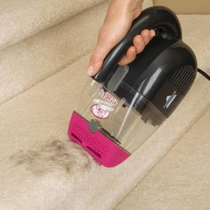 The Pet Hair Eraser® Corded Handheld vacuum is designed to help you get your entire home clean and hair-free, even in the hard-to-reach areas. The pet hair vacuum has two nozzles: a hard nozzle and a flexible contour nozzle. The hard nozzle is perfect for picking up dry messes like spilled cat litter or dog food, while the contour nozzle's rubber material and comb-like bristles will help collect pet hair from your stairs and upholstery.