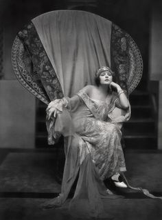 Publicity Photograph, actress Norma Talmadge in large wicker chair, 1922