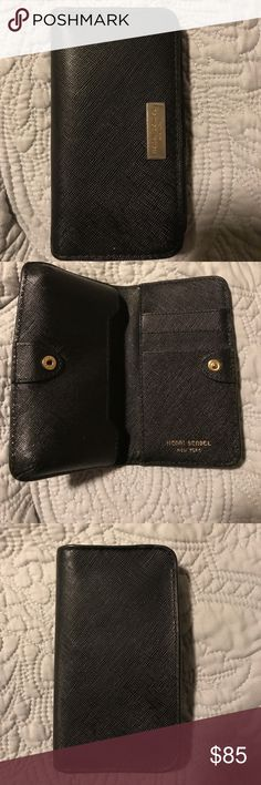 Henri Bendel wristlet/wallet Super great condition! This can be used with the iPhone 5 or similar size phone. It is very sleek. It has a small amount of visible wear. Perfect for a night out or when you only need the necessities. henri bendel Bags Clutches & Wristlets