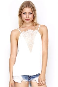 Drunk In Love Ivory Price: € 30.00  We love this ivory chiffon camisole top with lace detail from the WYLDR range.
