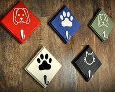 The perfect leash holder for a doorway! Compact and cute, available in 5 colors! Solid wood, finished with Chalk paint, lightly distressed with a coordinating hook to hold your best friends leashes, leads or harnesses. Dog Leash Holder, Cat Leash, Paw Print Art, Dog Crafts, Dog Paws, Pet Accessories, Etsy, Vinyl Art, Decoupage
