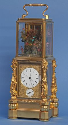 An exceptional French singing bird carriage clock by Japy Freres. The bird tweets, rotates and bobs when activated either by the clock or on command.