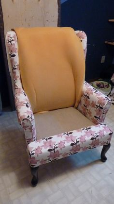 Detailed instructions for reupholstering a wing chair.