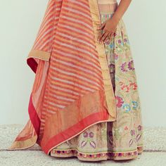 Woven Wonders of Banaras  - A gold tissue lehenga with menakari would be timeless for the traditional Pheras.