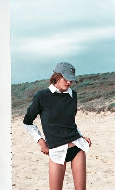 Beach outfit. Black sweater, white blouse. NY Hat. Swimming suit. Perfect beach outfit