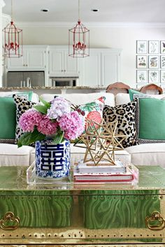 Mixing of bright  colors and patterns with bamboo accents is one of the defining elements of a Palm Beach Regency style.