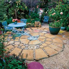 Squares and rounds    Colored stones, surrounded by pavers of stained concrete, create the illusion of a stream bubbling through the center of this 12-foot patio in Berkeley, Calif.