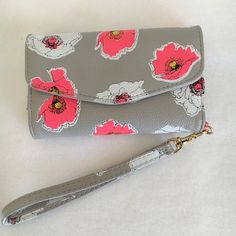 Iphone 5/5S Wallet Case Grey faux leather. Bright pink floral design. Holds an iPhone 5 or 5S. 3 cardholder pockets & one larger pocket for money. Removable wrist strap. NO TRADES OR PAYPAL. Accessories Phone Cases