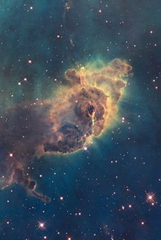 A pillar of gas in the Carina Nebula is bathed in the light of hot, massive stars. Photo of Carina Nebula Pillar. Poster on VintPrint.com.