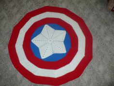 Captain America lap blanket! She even links to the patterns she combined o make it.