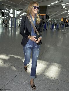Braided: The model wore her hair in a thick braid which worked well with her chic airport look