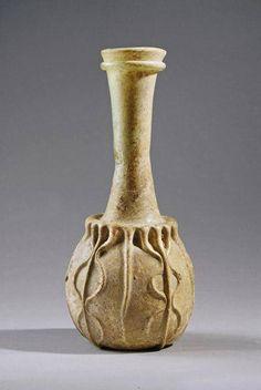Iran,Sassanian Pinched Glass Flask, 3rd century AD. بطری شیشه ای یا صراحی، قرن سوم میلادی، هنر ساسانی. By: Virtual Museum of Iran Art on Facebook. IranologySociety.