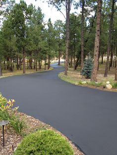 Asphalt With River Rock Edge Example Photo Of Driveway