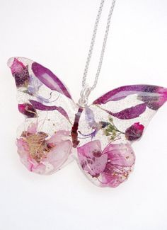 Resin jewelry Etsy - For Artists Exposed Real flower butterfly necklace custom made resin jewelry dried flowers favorite flowers favorite colors. Resin Jewelry, Jewelry Crafts, Handmade Jewelry, Jewellery Box, Jewellery Shops, Resin Necklace, Necklace Chain, Jewelry Stores, Jewelry Ideas