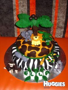 Ella's 1st Birthday Safari Cake. I modelled all the animals out of fondant. The tree was a challenge but turned out well.
