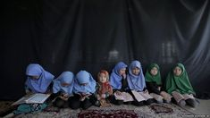 Afghan girls attend a class on how to read verses of the Koran in a mosque in Kabul.