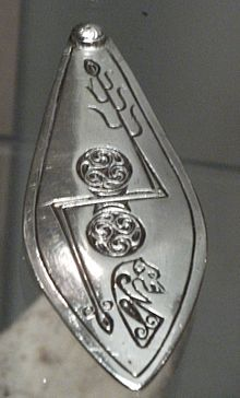 The Aberlemno Serpent Stone, Class I Pictish stone, showing (top to bottom) the serpent, the double disc and Z-rod and the mirror and comb