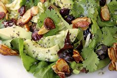 Cranberry-Avocado Salad with Candied Spiced Almonds and Sweet White Balsamic Vinaigrette I'd make a few substitutions- sounds delicious!!