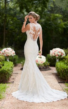 Stella York 6418 - This vintage lace trumpet wedding dress by Stella York features lace and tulle over lavish satin that creates a sleek silhouette. A soft organza back plays into a substantial train with a scallop lace edge finish for a truly romantic walk down the aisle. The deep sweetheart neckline is accented by illusion lace straps that create a comfortable, yet glamorous neckline. A zipper closure is hidden under fabric-covered buttons. This beautifully vintage wedding dress is…