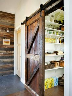 Barn Doors on your Food Storage Pantry. Kind of cool...and the rustic wall to the left.