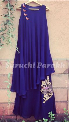 Beautiful asymmetrical dress with zardosi bird and cage by Suruchi Parakh