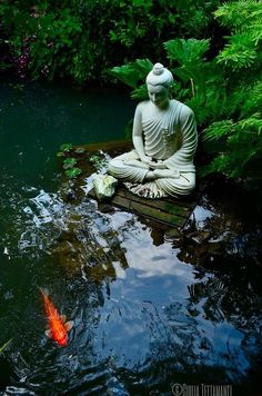 Beautiful garden with buddha watching over the pond...