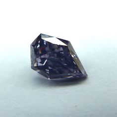 This is a beautiful .39 carat, GIA certified Natural Fancy Grayish Violet diamond, Modified Kite shape and cut Diamond with an SI2 clarity grade. A beautiful Natural Fancy Grayish Violet that will look stunning when set into any jewelry piece. This loose diamond has the color of the purple jam, its a super rare and amazing colored diamond. Let one of our Diamond Specialists help you.