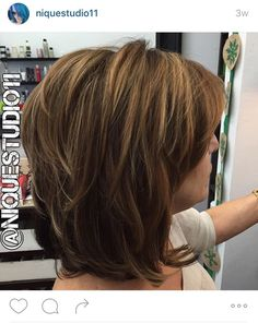 Short layered medium length haircut. Lots of layers in this hair, long bob (lob). Medium golden brown base color with fine highlights throughout. Follow on In