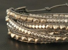 Metal Head, combination of silver nuggets and silver beads strung on metallic silver leather, 5-wrap bracelet $98