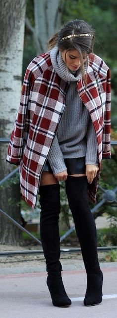 Winter Styles plaids coat, grey knit sweater and black booties.