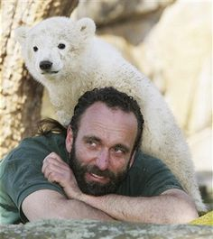 Knut the three-month old baby polar bear plays with his minder zoo keeper Thomas Doerflein under the cheering gaze of the public at the Berlin Zoo March 27, 2007 in Berlin, Germany. Knut was rejected by his mother and animal activists have said Knut should be put down, though zoo officials have vowed to nurse him to maturity with human help. Hundreds of visitors gather at Knut's enclosure every day to watch Knut play.
