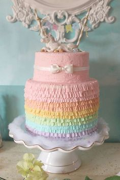 Rainbow ruffle cake at a unicorn birthday party! See more party ideas at CatchMyParty.com!