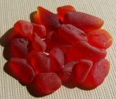 """True Red is-- in many people's opinion-- the pinnacle, or Holy Grail of sea glass collecting. It is also one of the brightest and more beautiful colors among the rarities.     Although red is not actually the rarest sea glass color, many collectors speak of it as the most """"important"""" rarity; the """"royalty"""" of sea glass. Jewelry makers and artists working with sea glass use it only sparingly, due to the difficulty obtaining it, and the premium price commanded if you were to buy it."""