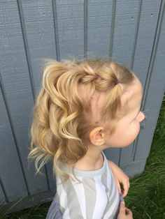 This hairstyle is easy to do and perfect for hard to manage, fine, toddler hair. Try this Waterfall Pull Through Braid on your little girl!